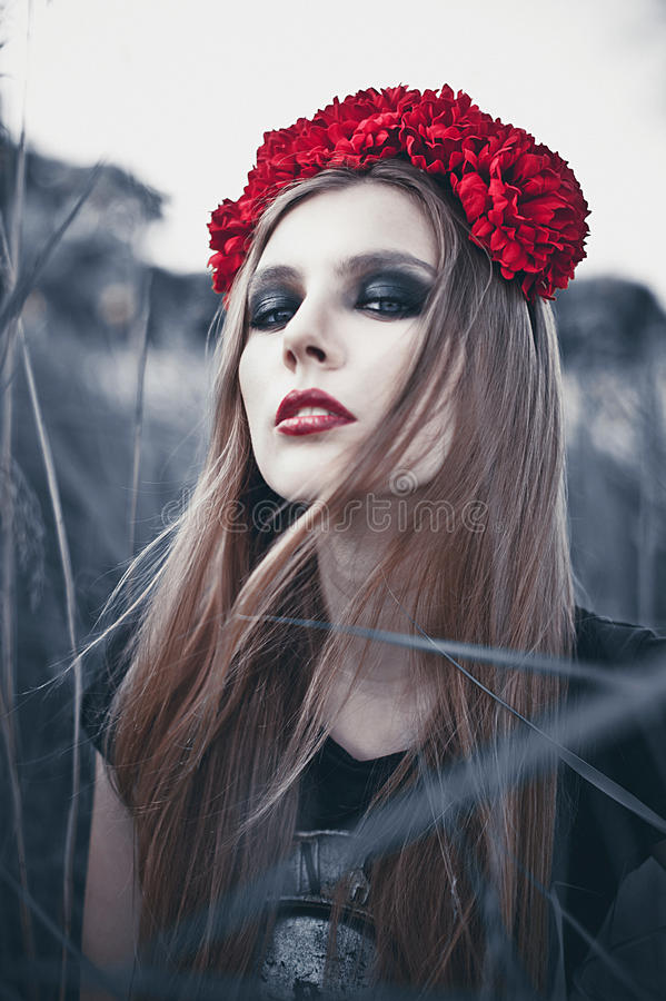 Portrait of Fashion Beautiful Woman on Nature. Pure Beauty Mode. L Girl. Perfect bright smoky Makeup. With Flower Wreath. Cold toning. Punk, rock, gothic stock photo