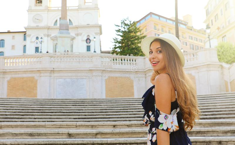 Portrait of fashion beautiful young woman on the Spanish Steps famous landmark of Rome. Summer holidays in Italy. Copy space area stock images