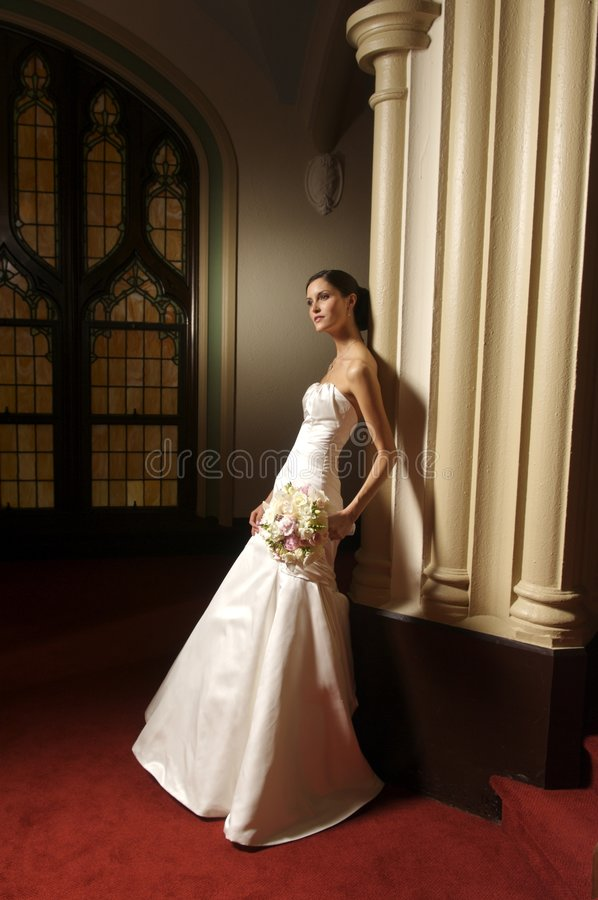 A portrait of a fashion bride. An image of a bride holding her bouquet royalty free stock image