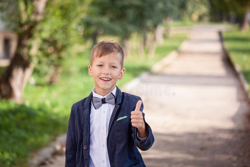 Portrait of fashion child. Funny little boy. 7 years old stock photo