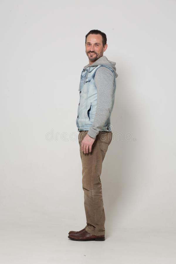 Portrait of fashion dressed man. Tall young handsome men in fashion clothes on white background. men concept royalty free stock images