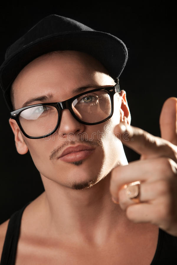 Portrait of fashion male model in glasses royalty free stock images