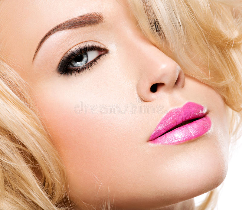 Portrait of fashion model with bright pink lips and black makeu. P of eye stock images