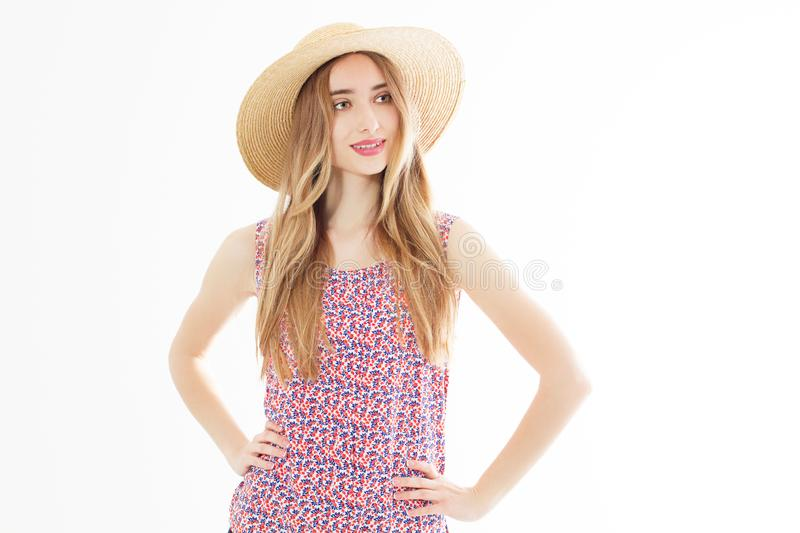 Portrait of Fashion Young woman in Dress. Pretty Girl in Hat. Female model in Stylish Summer Outfit. Vanilla Color. Beautiful Lady stock image
