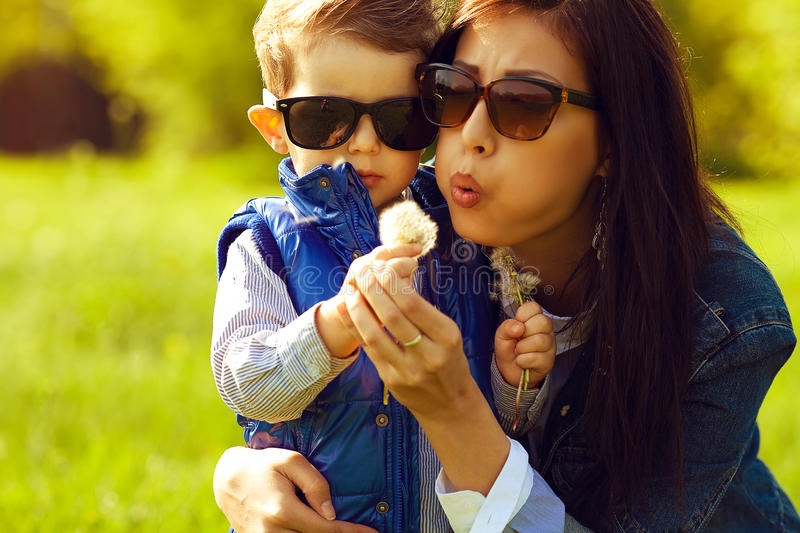 Portrait of fashionable baby boy and his gorgeous mother stock photo