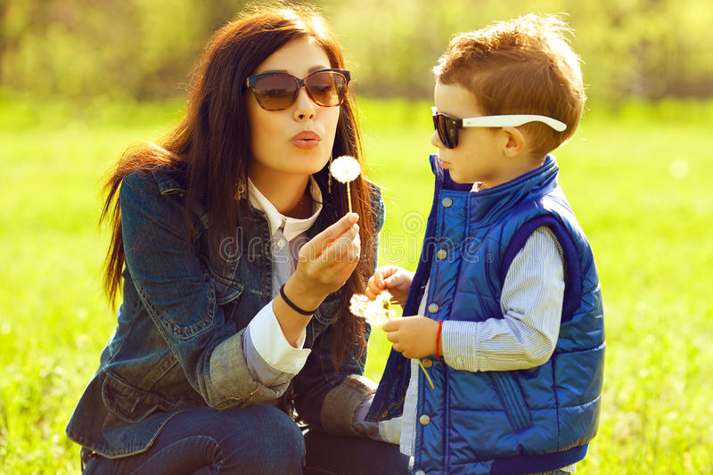 Portrait of fashionable baby boy and his gorgeous mother stock image