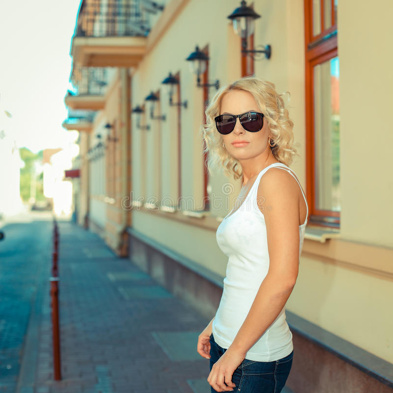 Portrait of fashionable blonde girl stock photo