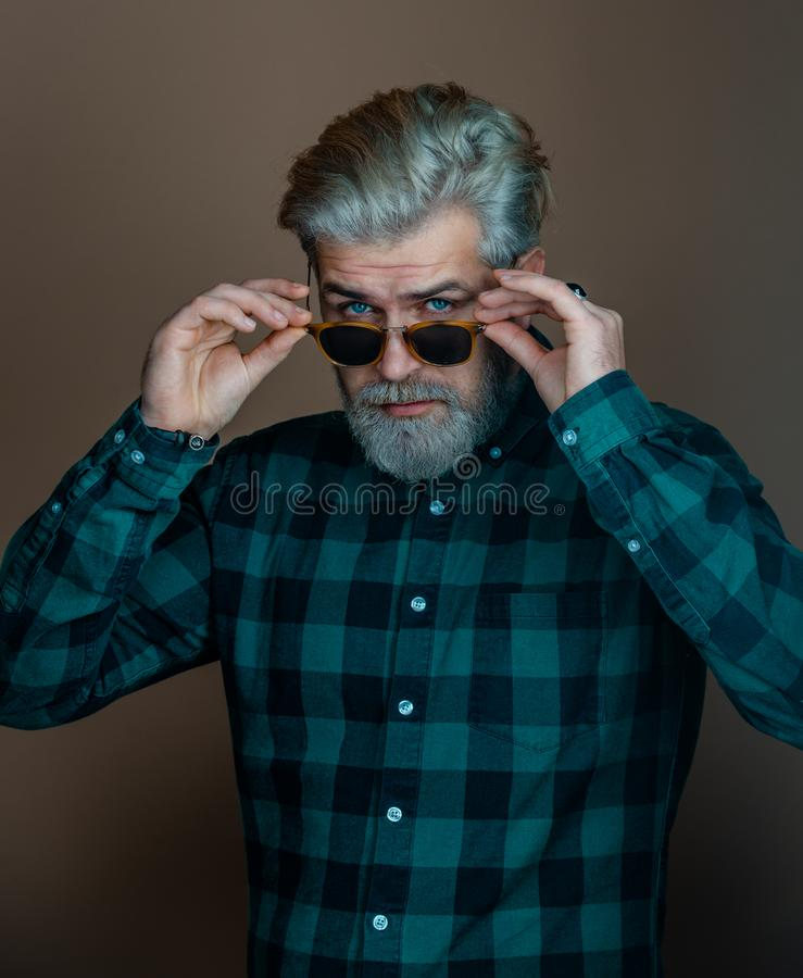 Portrait of fashionable handsome man in look at camera. Man with fashion sunglasses. Handsome man - studio portrait. stock image