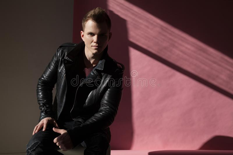 Portrait of fashionable men in leather jacket stock image