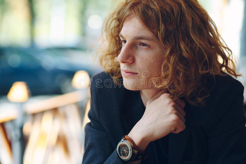 Portrait of fashionable reddish young man posing stock photography