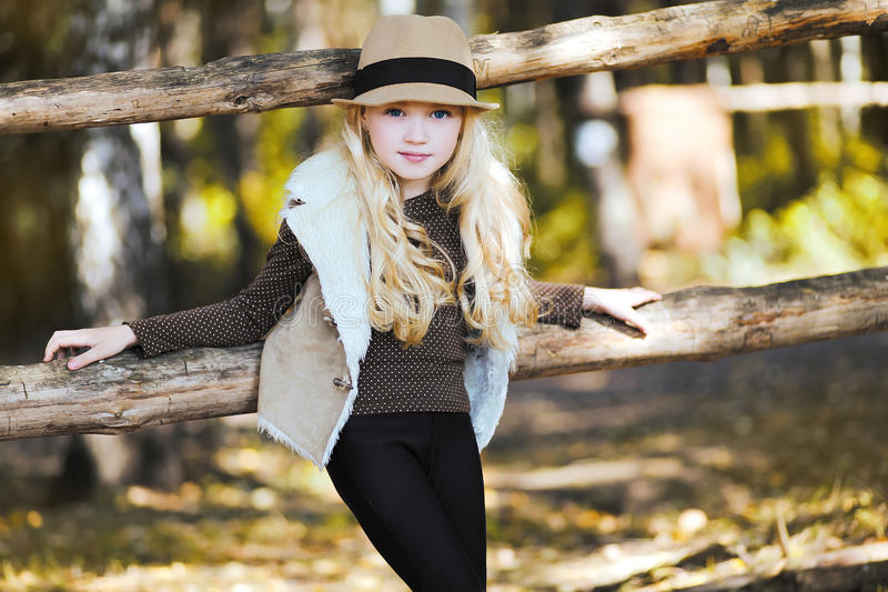 Portrait fashionable teen girl, blonde. Country, rustic, ranch - style royalty free stock photo