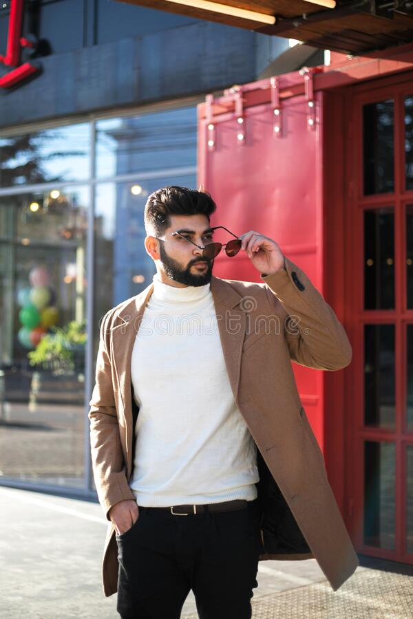 Portrait of fashionable well dressed bearded man at street. stock photography