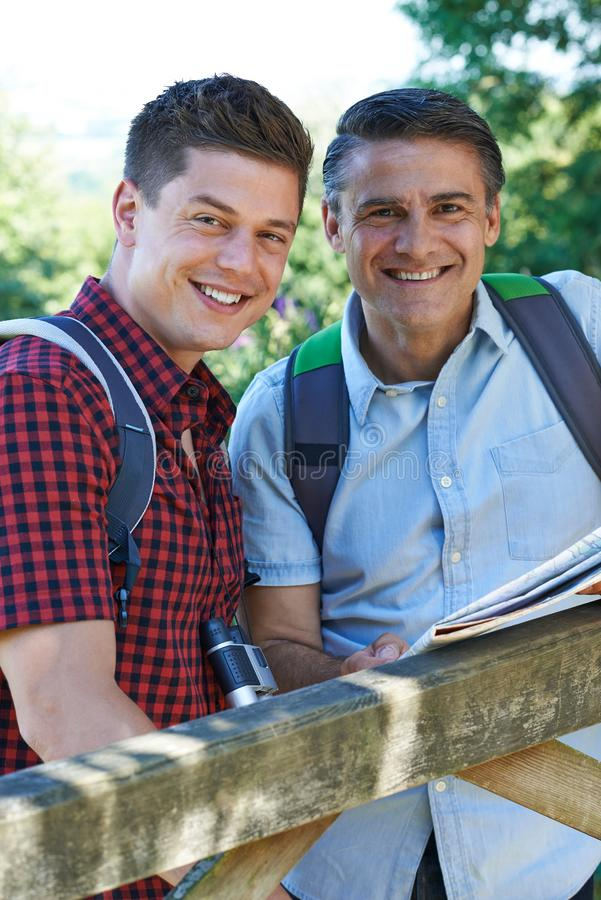 Portrait Of Father With Adult Son On Walk In Countryside stock photography