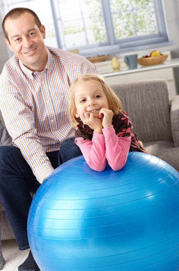 Download Portrait Of Father And Daughter With Fit Ball Stock Image - Image: 24277931