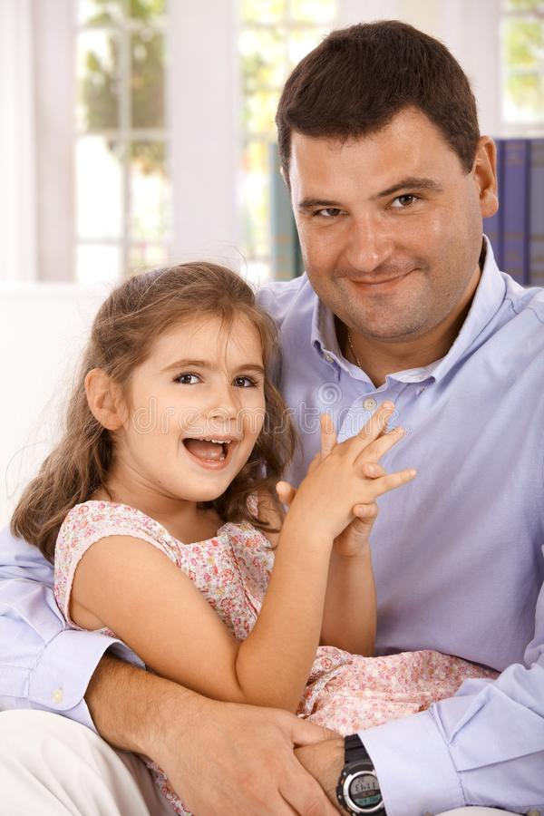 Portrait of father and daughter smiling royalty free stock photo