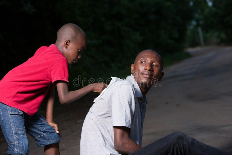 Portrait of a father and his child royalty free stock image