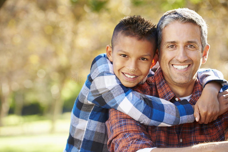 Portrait Of Father And Son In Countryside royalty free stock photos