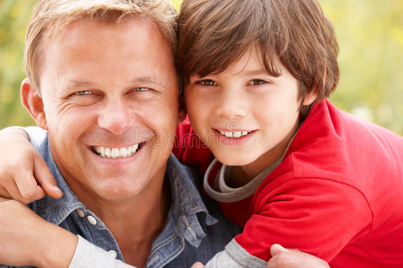 Portrait father and son outdoors royalty free stock image