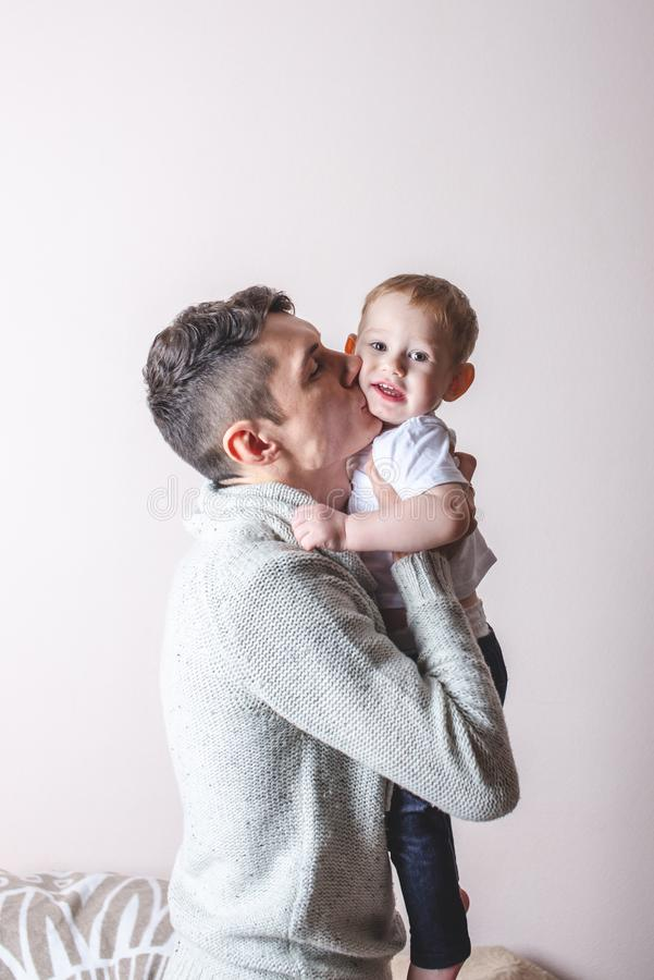 Portrait of father and son`s baby. Fatherhood, love and protection of children. Family and continuity of generations. Portrait of father and son`s baby royalty free stock images