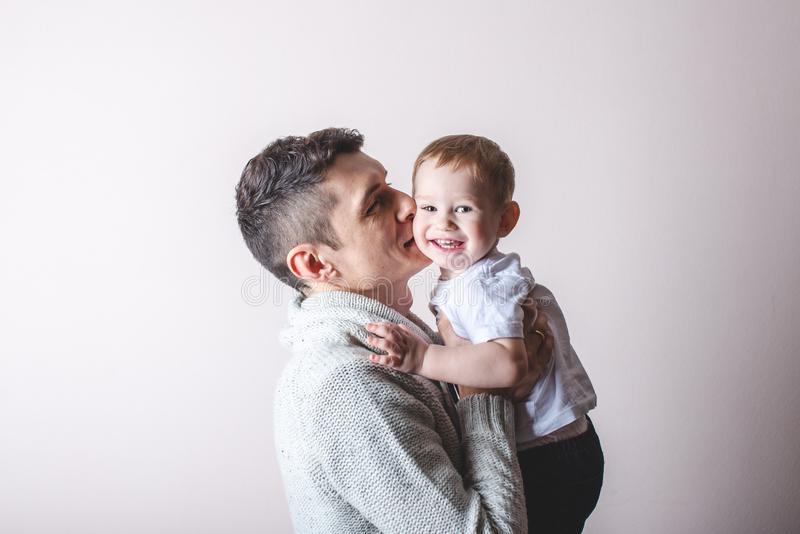 Portrait of father and son`s baby. Fatherhood, love and protection of children. Family and continuity of generations. Portrait of father and son`s baby stock photo