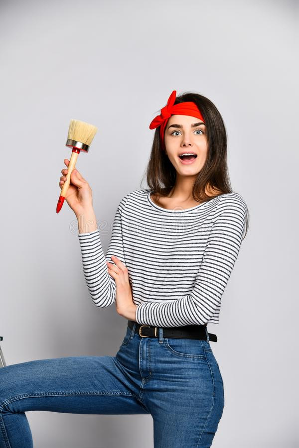 Portrait of a female artist with a wide brush royalty free stock photos