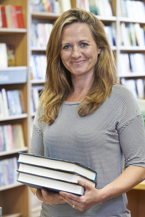 Portrait Of Female Bookshop Owner. Female Bookshop Owner In Store royalty free stock images