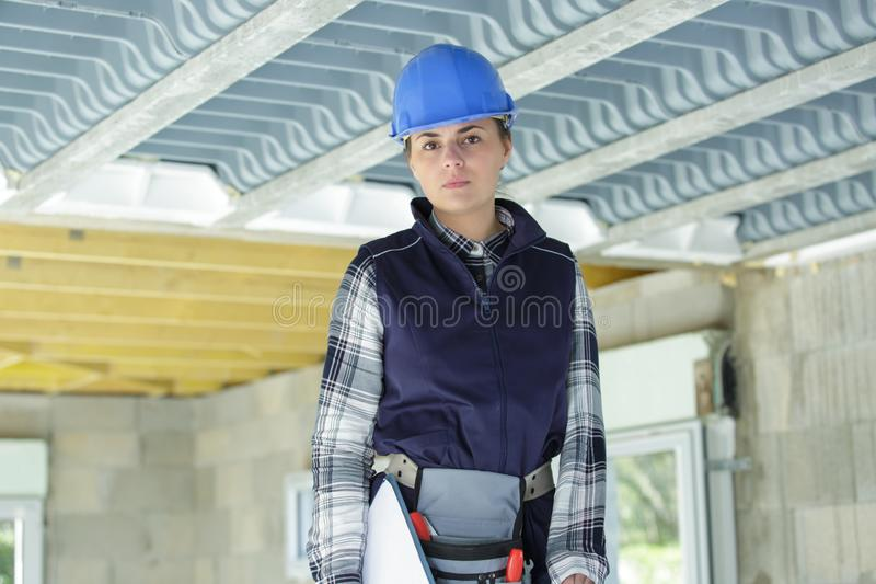 Portrait female builder on construction site royalty free stock images