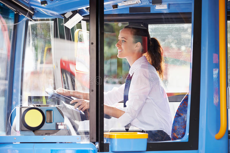 Portrait Of Female Bus Driver Behind Wheel stock images
