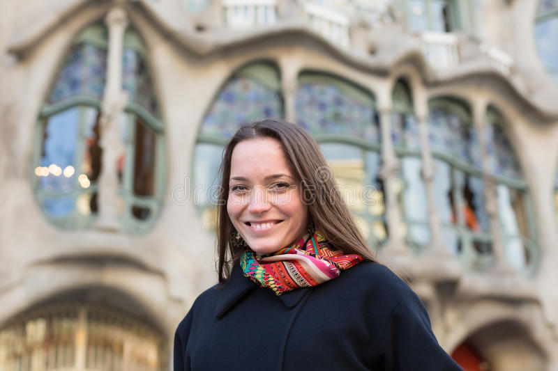 Portrait of female with Casa Batllo. Portrait of female tourist with Casa Batllo by Antoni Gaudi in background royalty free stock photography