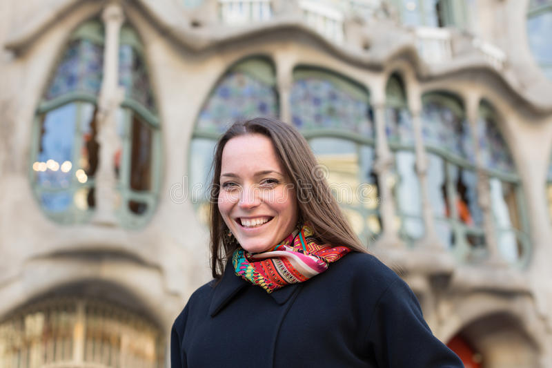 Portrait of female with Casa Batllo. Portrait of woman tourist with Casa Batllo by Gaudi in background. Barcelona, Spain royalty free stock photo