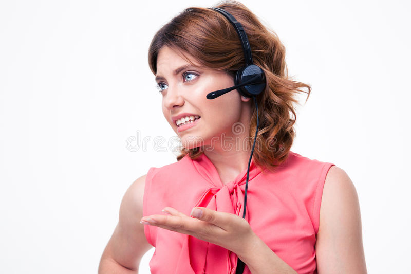 Portrait of a female customer operator. Portrait of unhappy female customer operator isolated on a white background stock images
