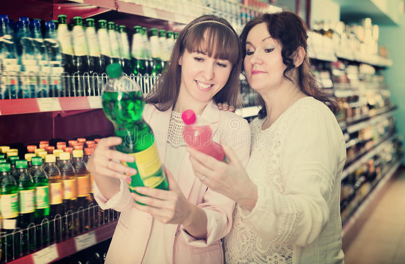 Portrait of female customers shopping in market stock photos