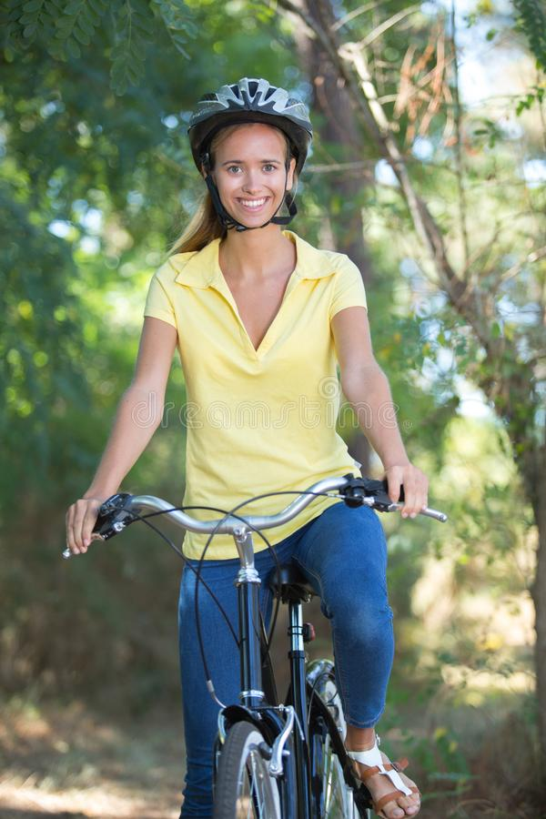 Portrait female cyclist wearing helmet in countryside royalty free stock image