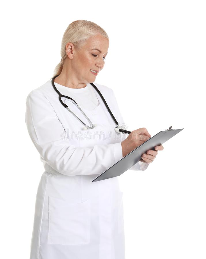 Portrait of female doctor with clipboard isolated. Medical staff. Portrait of female doctor with clipboard isolated on white. Medical staff stock photo