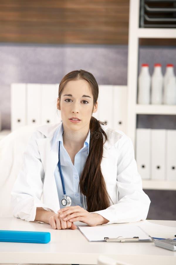Portrait of female doctor in office