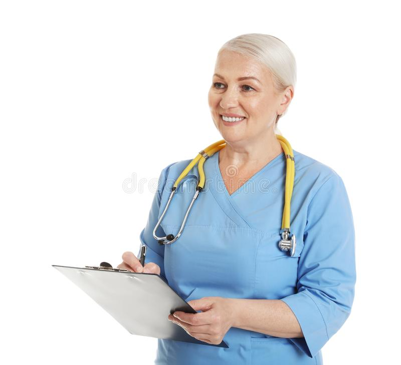 Portrait of female doctor in scrubs with clipboard isolated. Medical staff. Portrait of female doctor in scrubs with clipboard isolated on white. Medical staff royalty free stock photo