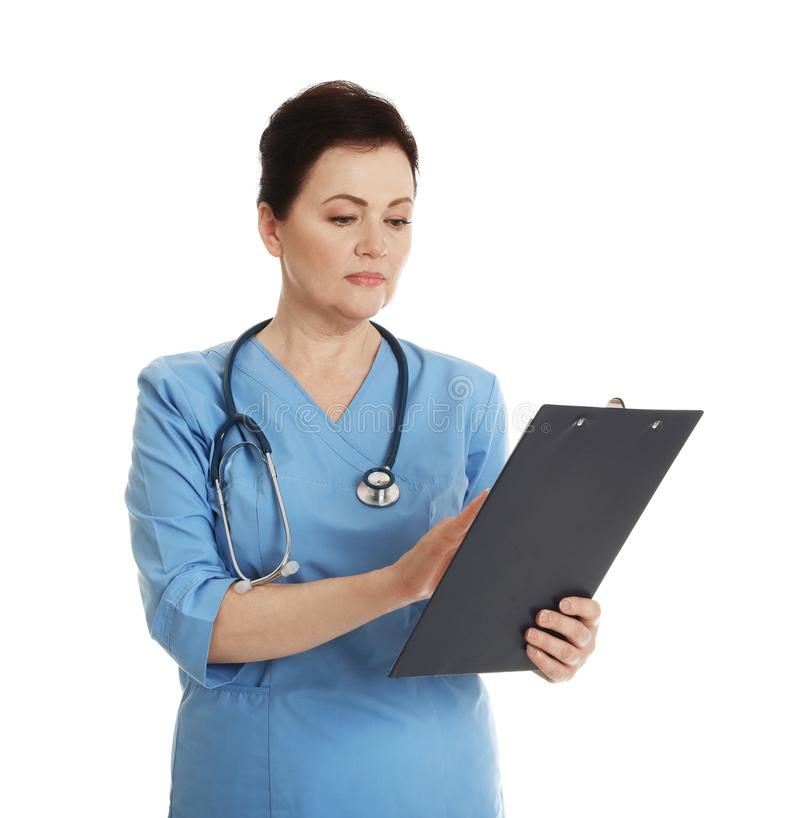 Portrait of female doctor in scrubs with clipboard on white. Medical staff. Portrait of female doctor in scrubs with clipboard isolated on white. Medical staff royalty free stock photos