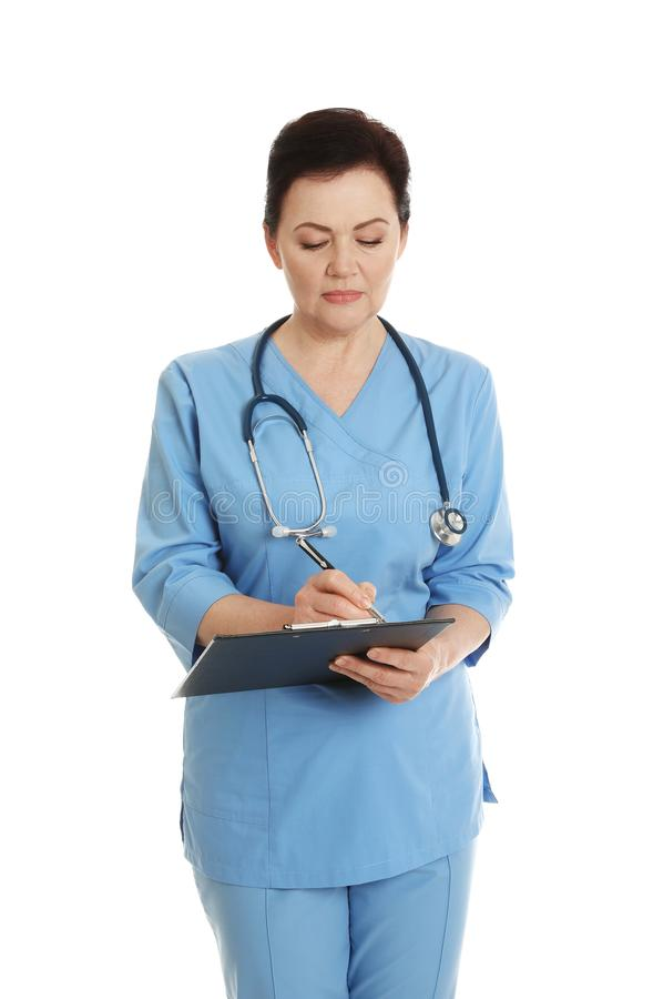 Portrait of female doctor in scrubs with clipboard isolated. Medical staff. Portrait of female doctor in scrubs with clipboard isolated on white. Medical staff royalty free stock photos