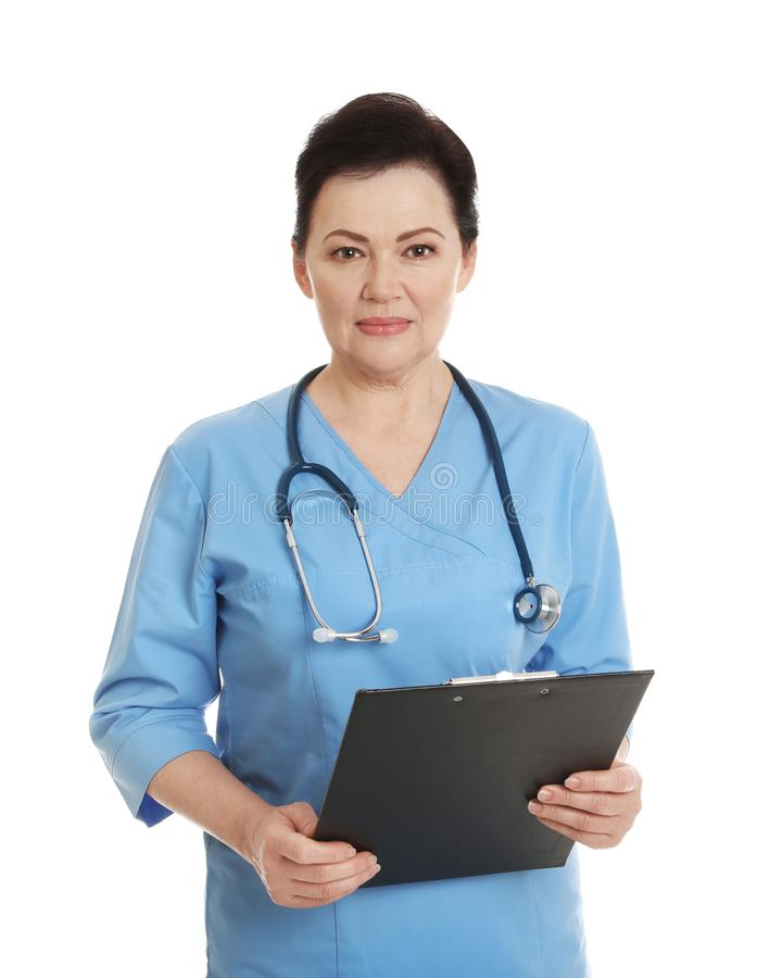 Portrait of female doctor in scrubs with clipboard. Medical staff. Portrait of female doctor in scrubs with clipboard isolated on white. Medical staff royalty free stock images