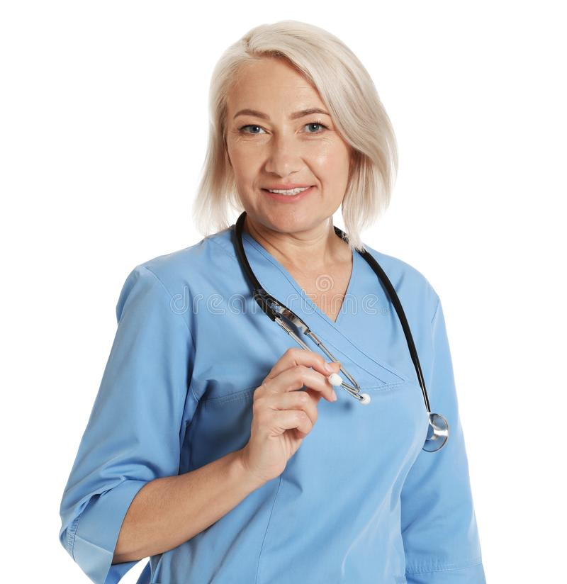 Portrait of female doctor in scrubs isolated. Medical staff. Portrait of female doctor in scrubs isolated on white. Medical staff stock image