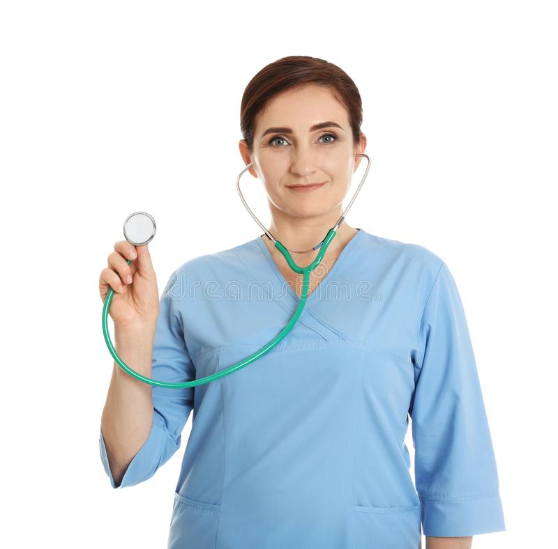 Portrait of female doctor in scrubs with stethoscope isolated. Medical staff. Portrait of female doctor in scrubs with stethoscope isolated on white. Medical royalty free stock photo