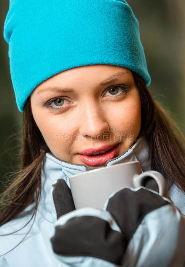 Portrait of female drinking tea. And wearing warm clothes outdoors when going in for winter sports stock photos