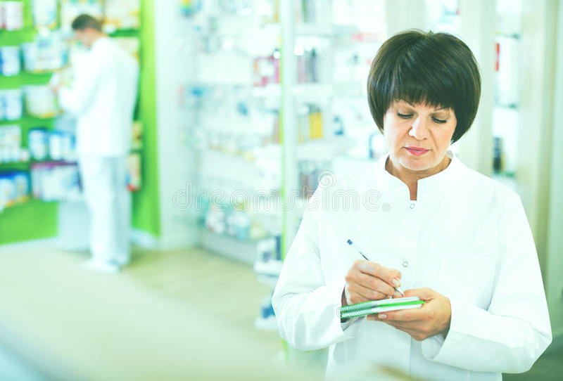 Download Portrait Of  Female Druggist Working In Pharmacy Stock Photo - Image: 83701976