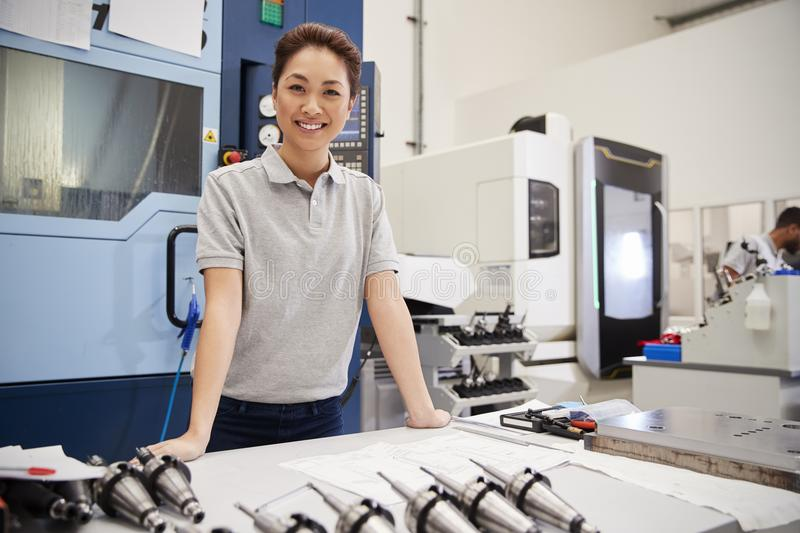 Portrait Of Female Engineer With CAD Drawings In Factory royalty free stock image
