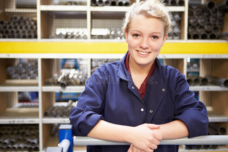 Portrait Of Female Engineering Apprentice In Store Room royalty free stock images