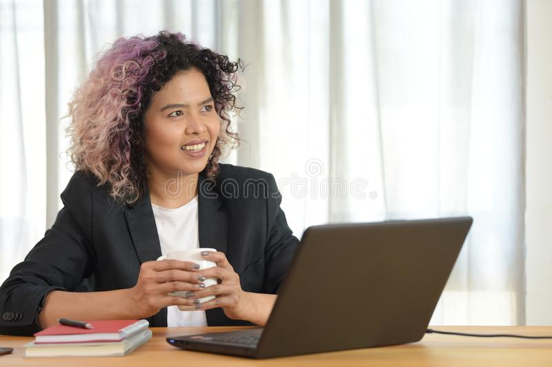 Portrait of female executive sitting at her desk royalty free stock photo