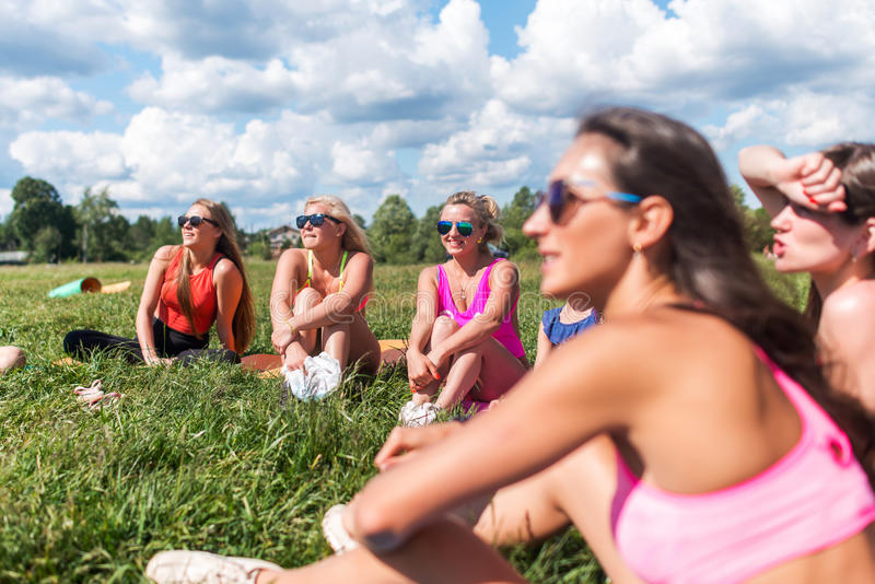 Portrait of female friends looking at camera smilling enjoying vacation.  royalty free stock photo