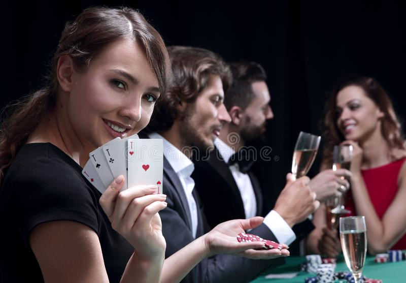 Portrait of the female gambler at the poker table with cards stock photo