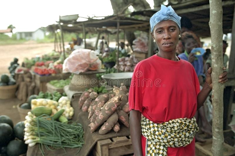 Portrait of female Ghanaian greengrocer on market. Ghana, central region, Effutu Municipal district, small town Winneba: close of Ghanaian woman selling fruit stock image