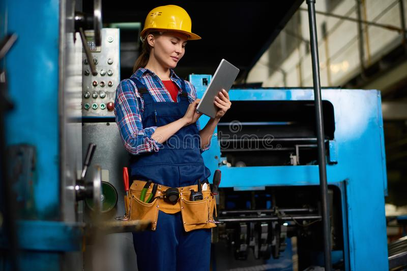 Female Technician Working at Factory royalty free stock photos